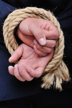 rope binding mans hands